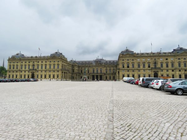 Residenz, a huge, fancy, building with a huge car park.