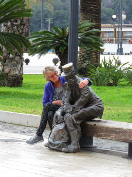 Jane hugging the sad soldier.  He's a memorial to soldiers from the Infantry Regiment 'España 18' by Fernando Sáenz de Elorrieta.