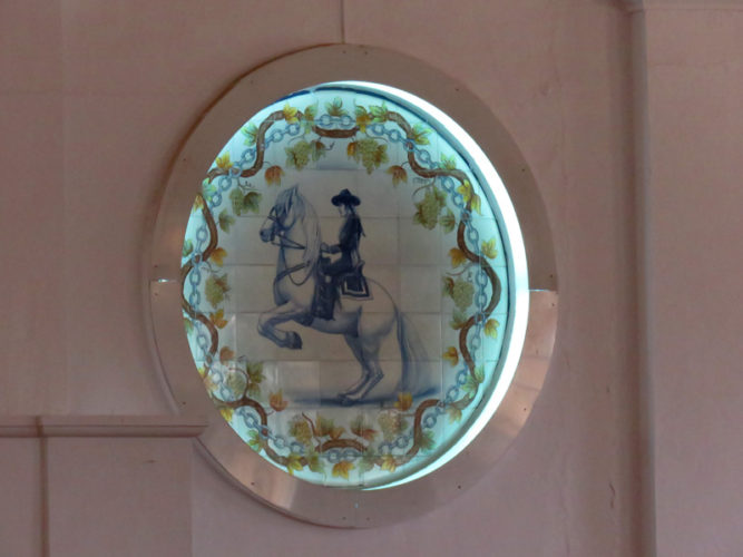 There were beautiful pictures of men on horses painted on the circular windows.