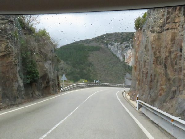 Along roads cut through the mountains