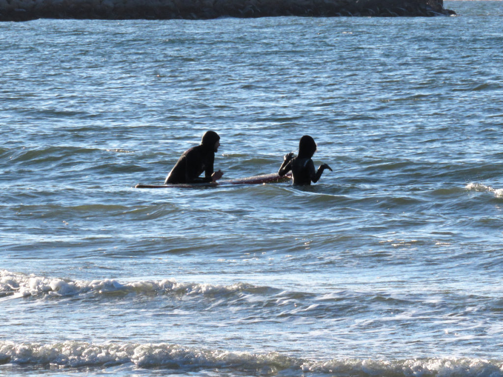 We could see the young lad cajoling the young girl to brave the icy water, looks like he succeeded!