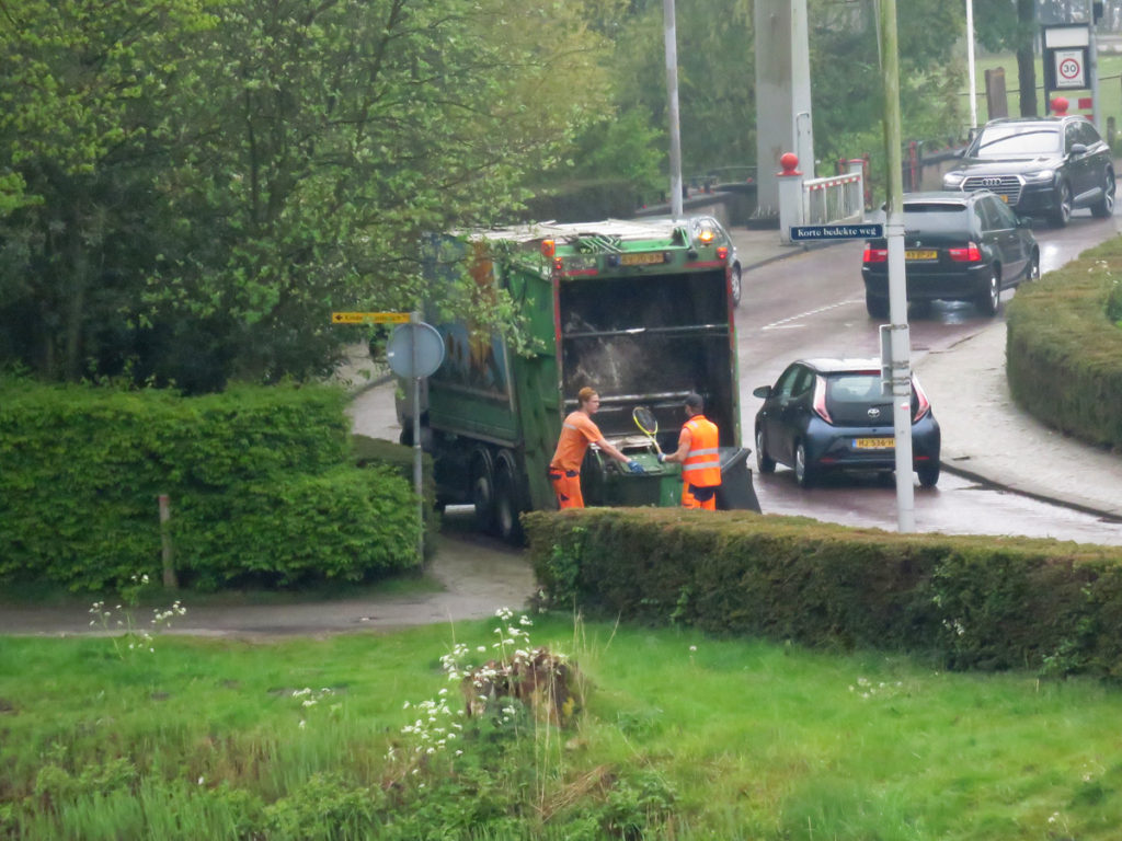 The lovely dustmen who smiled and waved to us.