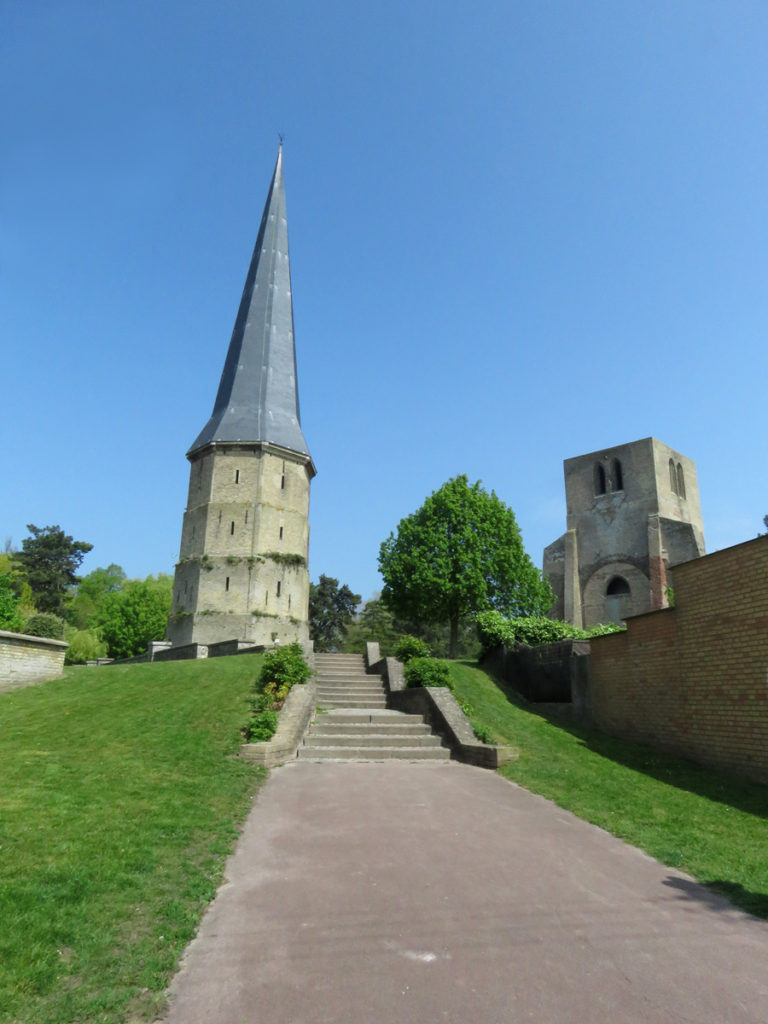 St Winoc Abbey remains. The Sharp Tower was repaired in 1812 to serve as a landmark for the sailors of the port of Dunkirk