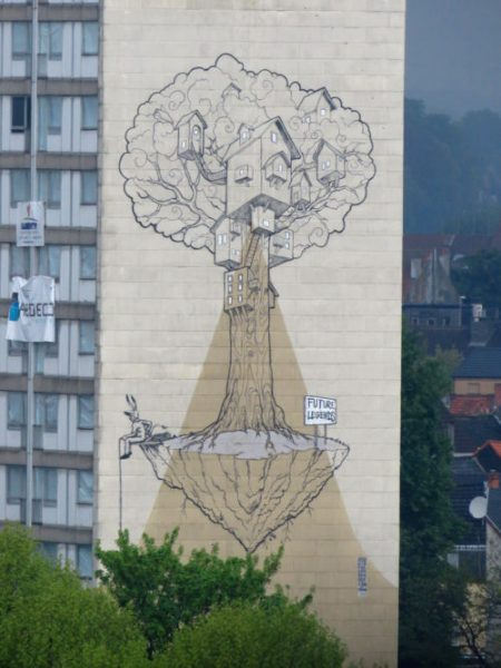 It must be a scary job painting artwork on blocks of flats but what a great idea.