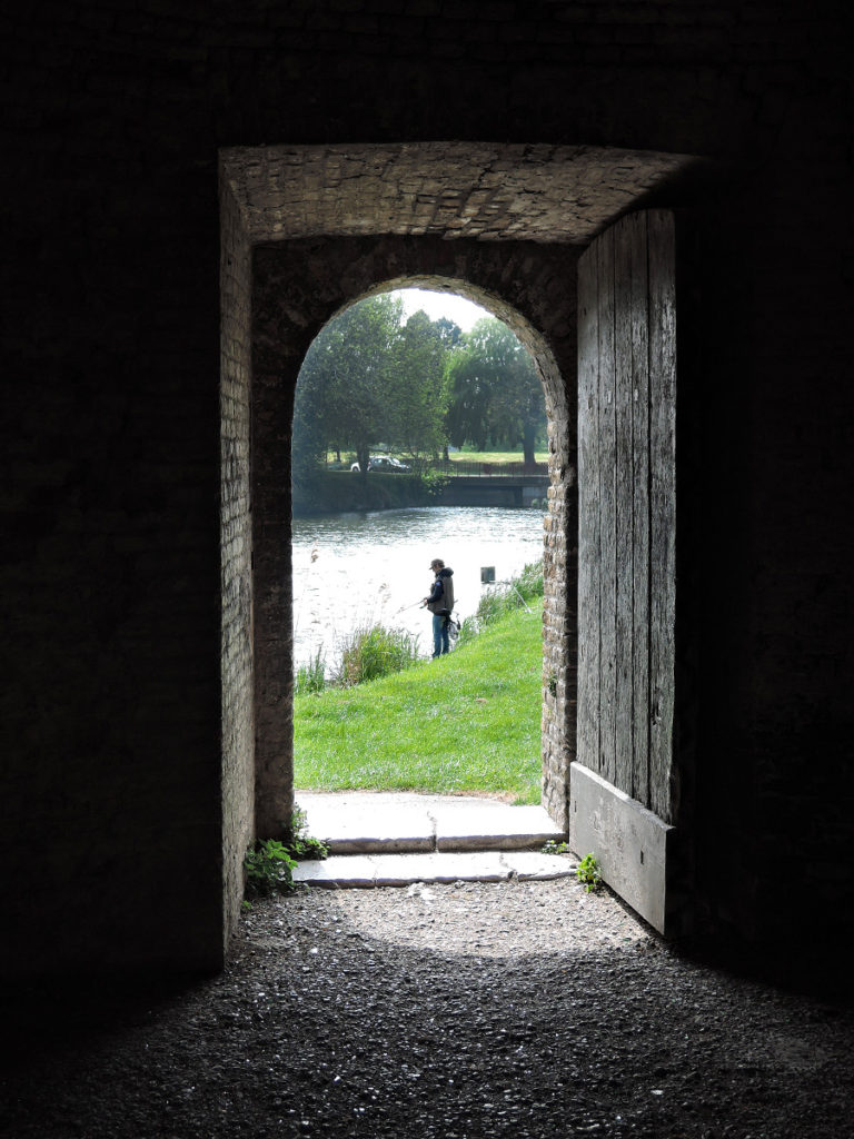 Returning to the aire via a door in the ramparts.